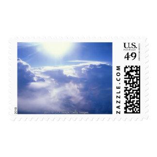 Sun shinning through clouds postage