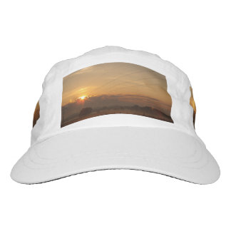 Sun surfaces above the clouds over foggy Pasture Headsweats Hat