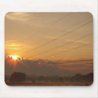 Sun surfaces above the clouds over foggy Pasture Mouse Pad