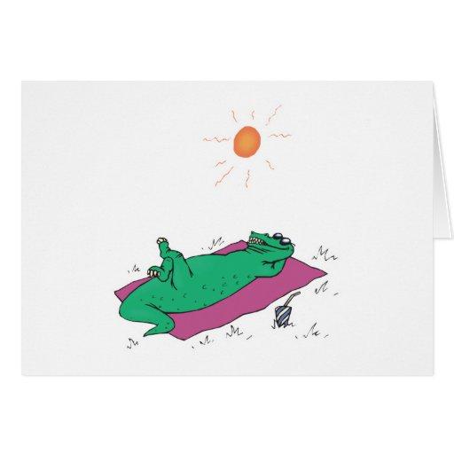 sun tanning crocodile greeting card