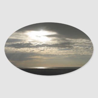 Sun Through Clouds on Antelope Island Oval Stickers
