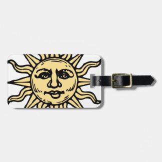 sun woodcut. luggage tags
