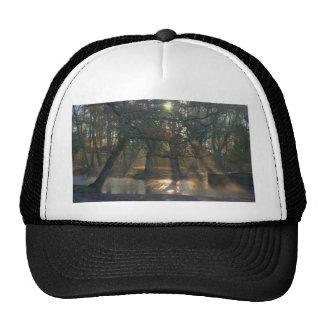 Sunbeams on misty river trucker hat