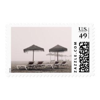 Sunbeds And Umbrella On Playamar Beach Postage Stamp