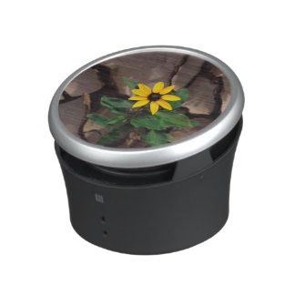 Sunflower growing from Cracked Mud Bluetooth Speaker