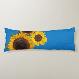 Sunflowers against blue fence body pillow