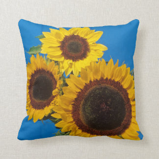 Sunflowers against blue fence throw pillow