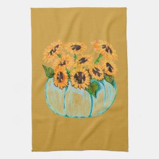 sunflowers in blue pumpkin vase kitchen towel
