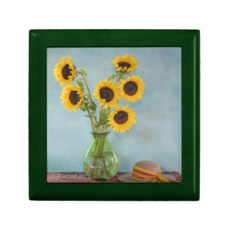 Sunflowers in vase on table jewelry box