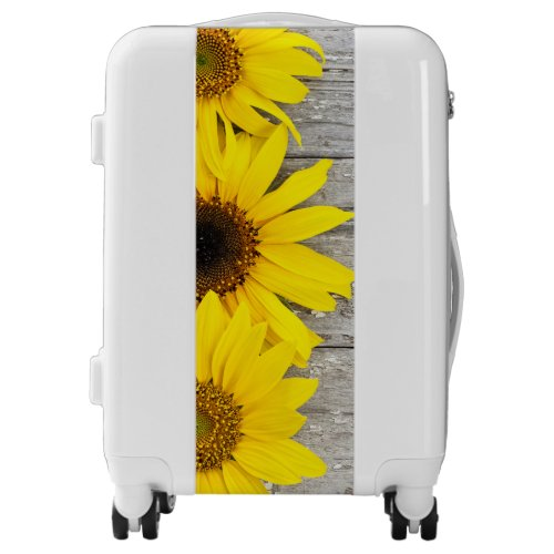 Sunflowers on a table luggage