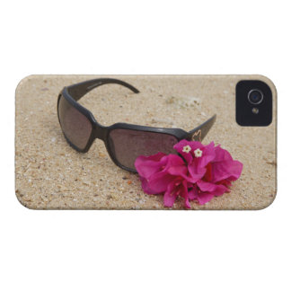 Sunglasses and bougainvillia flowers on coral iPhone 4 case