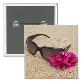 Sunglasses and bougainvillia flowers on coral pinback button