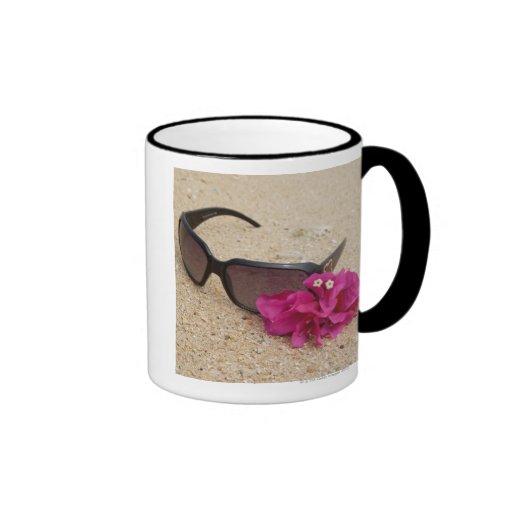 Sunglasses and bougainvillia flowers on coral ringer mug