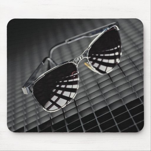 Sunglasses on grid background mouse pad