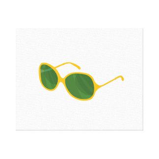 sunglasses orange frame green lenses beach.png canvas print