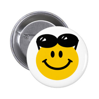 Sunglasses perched on top of head smiley face button