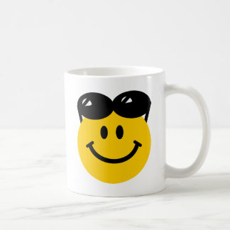 Sunglasses perched on top of head smiley face coffee mug