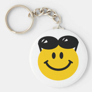 Sunglasses perched on top of head smiley face keychain