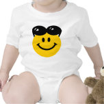 Sunglasses perched on top of head smiley face tshirt