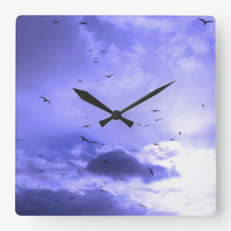 Sunlight and birds in a blue sky square wall clock