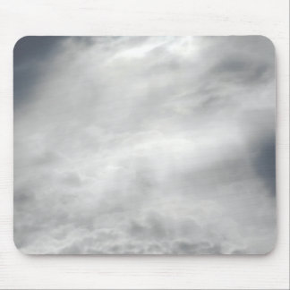 Sunlight piercing the clouds. mouse pad