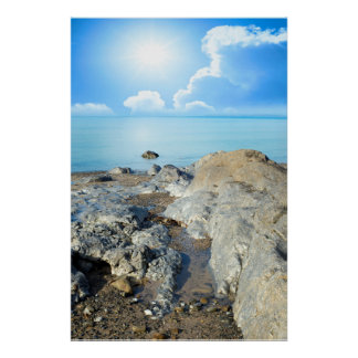 sunny day over the rocks poster