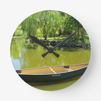 Sunny Summer Day with Canoe on the Water. Round Clock