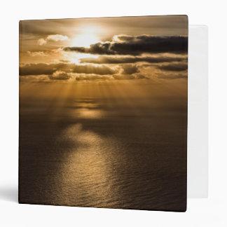 Sunrise above the Atlantic ocean Binders