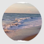 Sunrise along Florida beach choppy waves Round Sticker