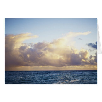 Sunrise and clouds over ocean greeting card