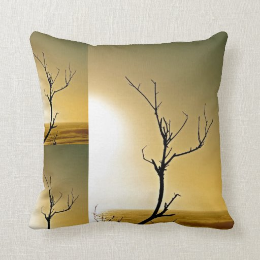 Sunrise and dried branches at the ocean in antique pillows