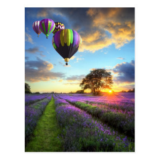 Sunrise and hot air ball remunerations above postcard