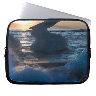 Sunrise and iceberg formation on the beach laptop sleeve