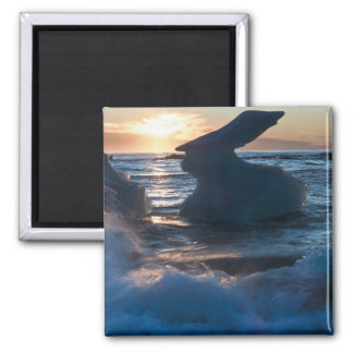 Sunrise and iceberg formation on the beach magnets