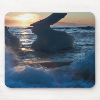 Sunrise and iceberg formation on the beach mousepad