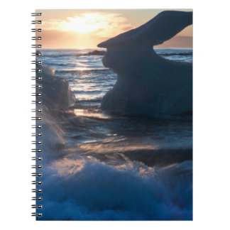 Sunrise and iceberg formation on the beach notebook