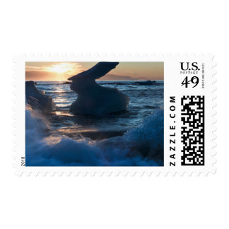 Sunrise and iceberg formation on the beach postage