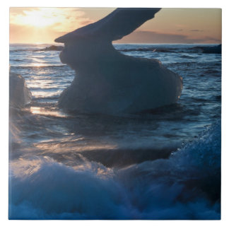 Sunrise and iceberg formation on the beach large square tile