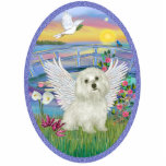 "Sunrise and Maltese Angel Statuette<br><div class=""desc"">A beautiful sunrise over blue waters and lily pads floating under a rustic bridge while a Maltese angel sits in the soft grass as the sun rises higher in the sky of a new day.</div>"
