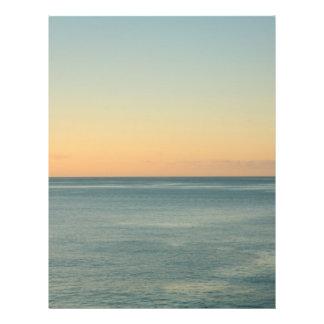 Sunrise and serene ocean flyer