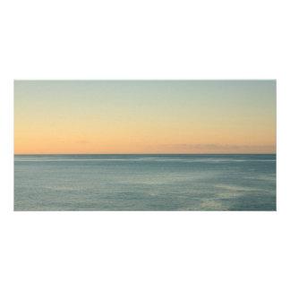 Sunrise and serene ocean photo card