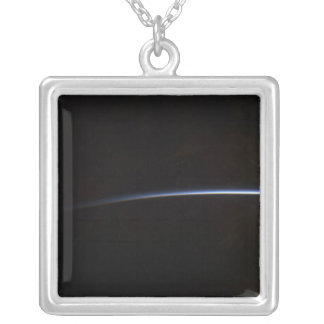 Sunrise as viewed in space silver plated necklace