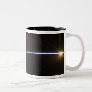 Sunrise as viewed in space Two-Tone coffee mug