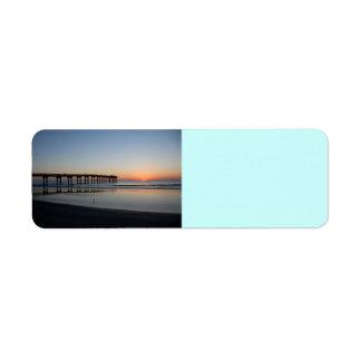 sunrise at fishing pier label