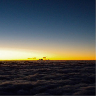 Sunrise image, photograph from above the clouds statuette