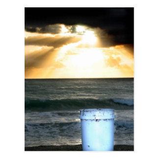 Sunrise on beach orange with blue bucket post cards