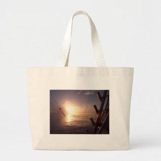 Sunrise on Ocean Canvas Bags