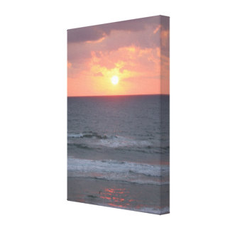 Sunrise on the beach Wrapped Canvas