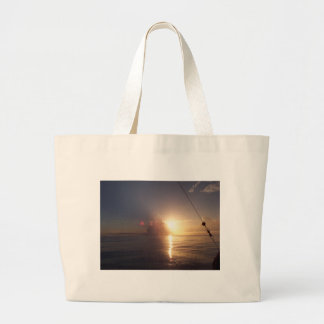 Sunrise on the ocean large tote bag