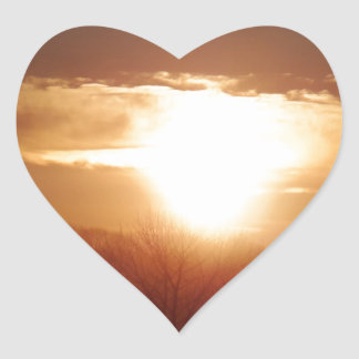Sunrise on the tree tops heart sticker